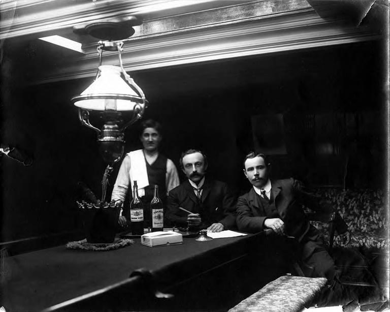 Wilhelm Hester, three man, ship's interior, about 1900